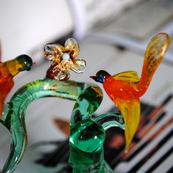 Glass branch with glass birds and glass flowers